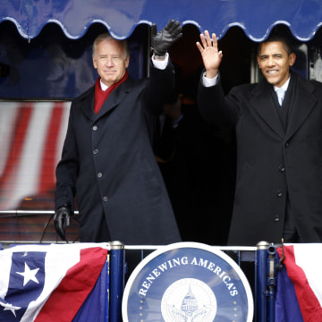 Image: U.S. President-elect Barack Obama is joined by U.S. Vice President-elect Joe Biden on the back of a train car during their whistle stop tour in Wilmington, Delaware, Jan. 17, 2009.