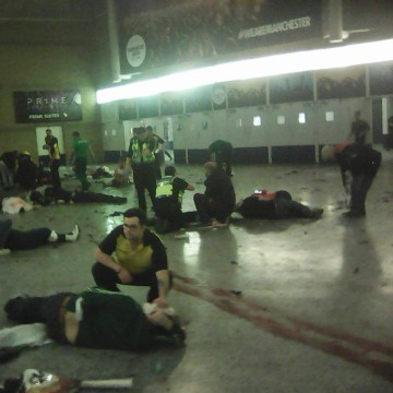 Image: Helpers attend to people inside the Manchester Arena after a suspected suicide bomber detonated an explosive device