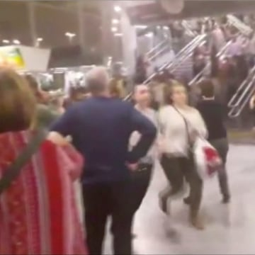 Image: People running down stairs as they attempt to exit the Manchester Arena after a blast on Monday