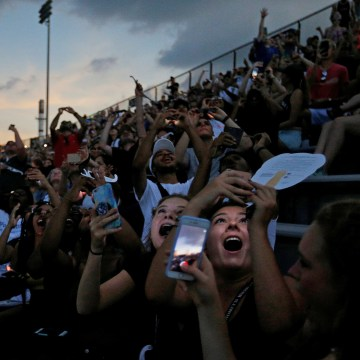 Image: Guests reacts to the total eclipse in the football stadium at Southern Illinois University in Carbondale