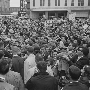 Image: President John F. Kennedy is greeted by an enthusiastic crowd in front of the Hotel Texas in Fort Worth