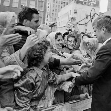 Image: President John F. Kennedy is greeted by an enthusiastic crowd in front of the Hotel Texas