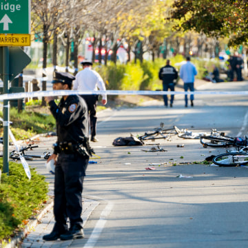 Image: Bicycles and debris lay on a bike path