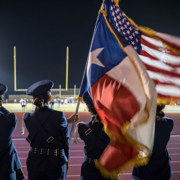 Image: The Panthers' color guard stands in position before the start of the game