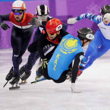Hongzhi Xu of China and Nurbergen Zhumagaziyev of Kazakhstan collide and crash out during the men's 1,500 meter short track speed skating heat on Feb. 10.