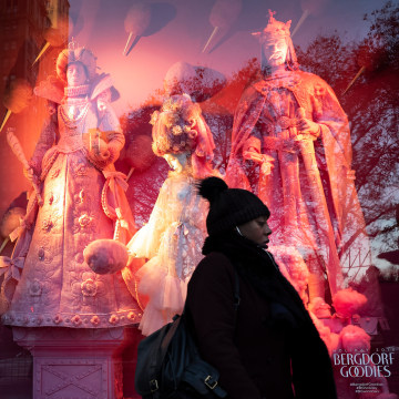 A woman passes a holiday window at Bergdorf Goodman, on Dec. 5, 2018, in New York.