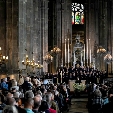 Image: Worshipers attend a tribute mass for Notre Dame Cathedral at the Saint Eustache Church in Paris on April 21, six days after a fire severely damaged the centuries-old church.