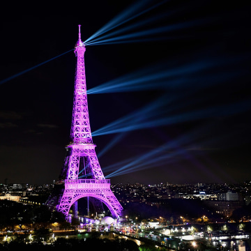 """A picture taken on October 1, 2019 shows the Eiffel tower illuminated in pink to mark the start of """"Octobre Rose"""" (Pink October) or Breast Cancer Awareness Month in Paris."""