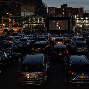 Patrons watch The Greatest Showman at the Bel Aire diner parking lot in Queens, N.Y., on May 25, 2020.
