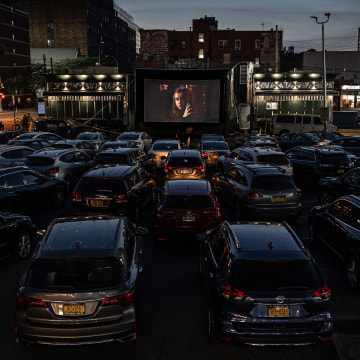 "Patrons watch ""The Greatest Showman"" at the Bel Aire diner parking lot in Queens, N.Y., on May 25, 2020.