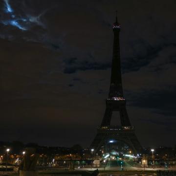 Eiffel Tower Celebrates Earth Hour In Paris