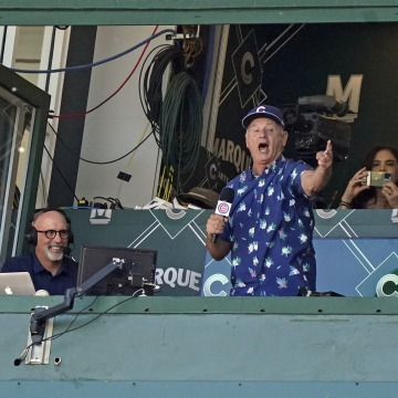 """Actor Bill Murray sings \""""Take Me Out to the Ball Game\"""" during the seventh inning of a game between the Chicago Cubs and the St. Louis Cardinals at Wrigley Field June 11, 2021 in Chicago, Illinois."""