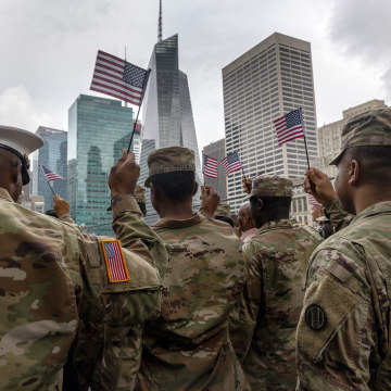 U.S. Army soldiers pose for a group shot after becoming American citizens at a naturalization ceremony July 2nd, 2021.