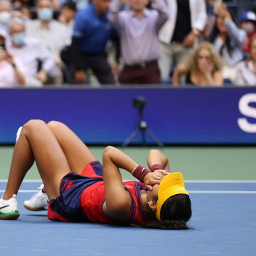 Emma Raducanu of Great Britain celebrates winning championship point to defeat Leylah Annie Fernandez of Canada during the second set of their Women's Singles final match on Day Thirteen of the 2021 US Open at the USTA Billie Jean King National Tennis Cen