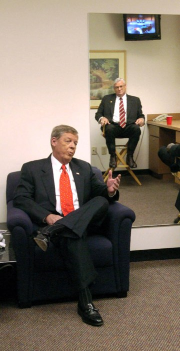 Republican candidates for Georgia's U.S. Senate seat presently held by Zell Miller, Johnny Isakson of Marietta, left, Herman Cain of Forest Park, right, and Mac Collins of Atlanta, reflected in the mirror on the wall, talk as they wait in the green room of WSB TV studios before the start of a debate between the three in Atlanta, Sunday, July 10, 2004.  (AP Photo/John Amis)