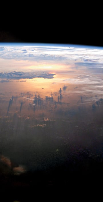 Sunset on the Pacific as seen from the International Space Station at an altitude of 235 miles on July 21, 2003.
