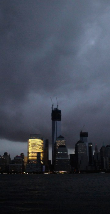 Image: A general view shows the skyline of lower Manhattan in darkness after a preventive power outage caused by giant storm Sandy in New York