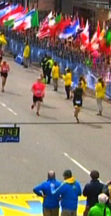 Image: NBC still image taken from video shows an explosion at the Boston Marathon