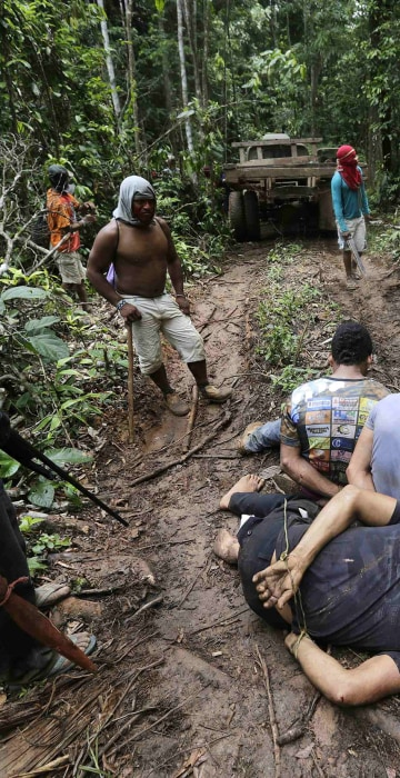 Image: Ka'apor Indian warriors tie up loggers during a jungle expedition in the Alto Turiacu Indian territory