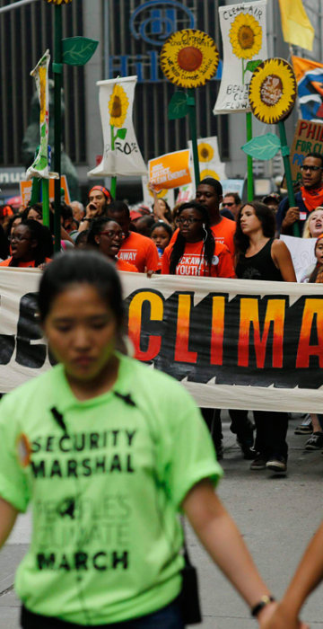 Image: People take part in a march against climate change in New York