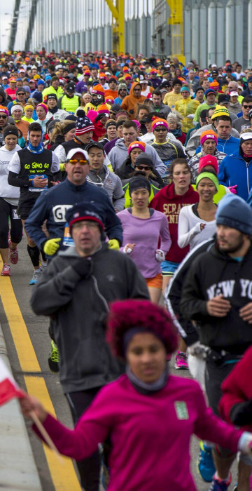 Image: Runners cross the Verrazano-Narrows Bridge shortly after the start of the New York City Marathon in New York