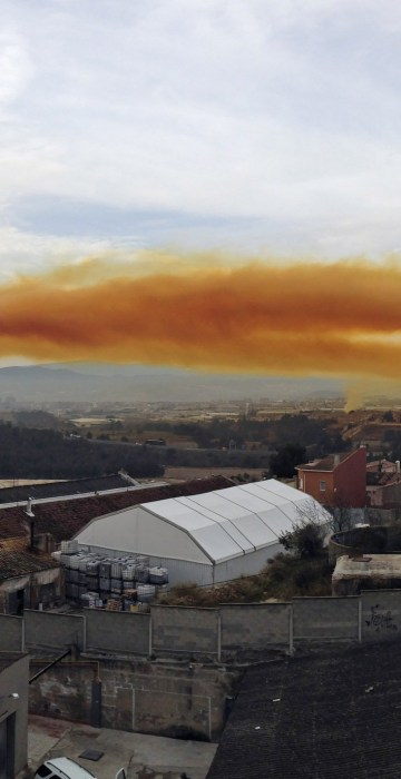 Image: Orange toxic cloud is seen over the town of Igualada, near Barcelona, following an explosion in a chemical plant