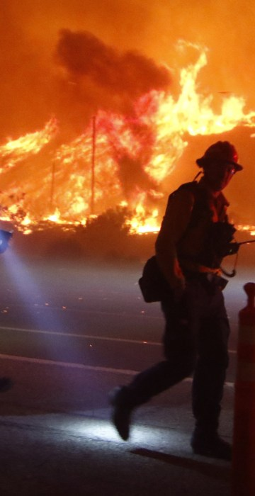 Image: Ventura County firefighters battle the Solimar brush fire that started early Saturday morning in Ventura County