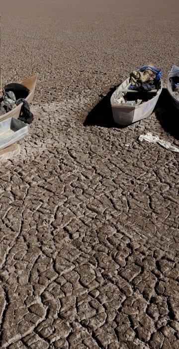 Image: Boats of fishermen are seen on the dried Poopo lakebed in the Oruro Department, south of La Paz