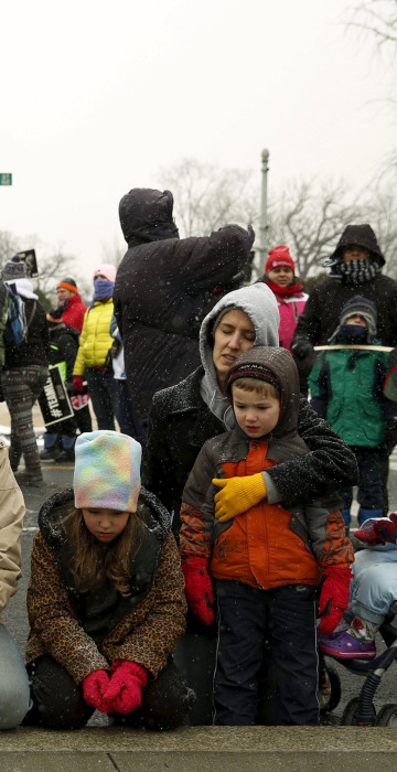 Image: DiIulio family from Fairfield, Pennsylvania prays in front of Supreme Court in Washington