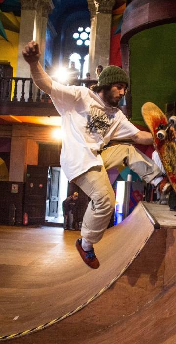 Image: A skater practices in a skate park inside the Santa Barbara church