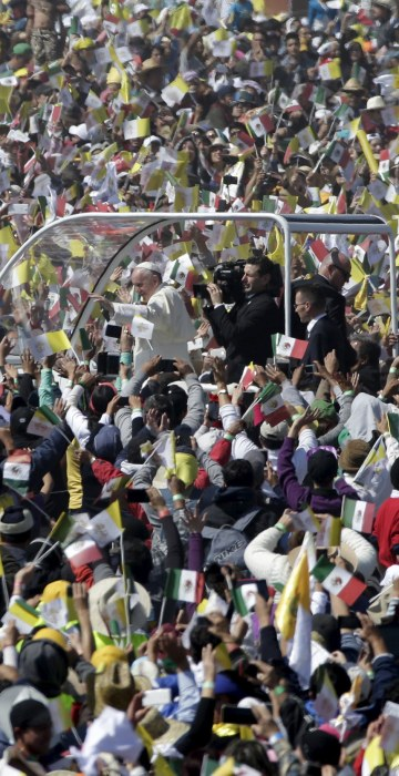 Image: Pope Francis arrives to celebrate Mass for a crowd of hundreds of thousands in Ecatepec, Mexico,