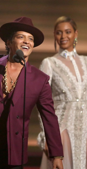 Image: Bruno Mars accept the award for record of the year