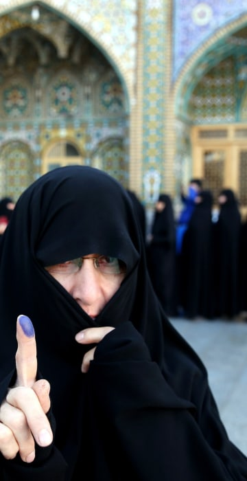 Image: Iranian Elections Woman Fingerprint Cover