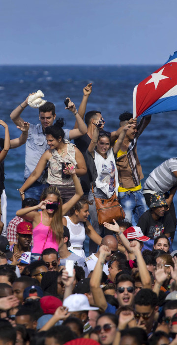 Image: Fans dance on Havana's seafront during a free concert