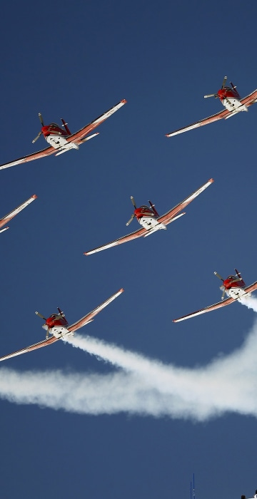 Image: Members of the Swiss Air Force PC 7 team fly in formation over the Alpine Skiing World Cup finals in St. Moritz