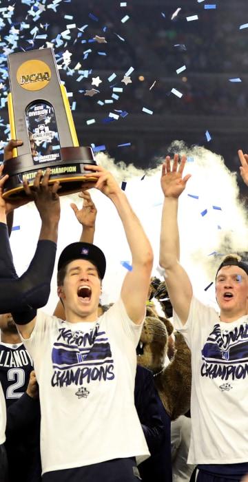 Image: Daniel Ochefu no. 23 of the Villanova Wildcats and Ryan Arcidiacono no.15 hoist the trophy after the Villanova Wildcats defeated the North Carolina Tar Heels 7