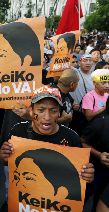 Image: Protesters holding signs attend a march against Peruvian presidential candidate Keiko Fujimori in downtown Lima