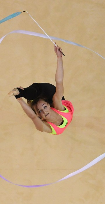 Image: A gymnast takes part in an open training session for the rhythmic gymnast
