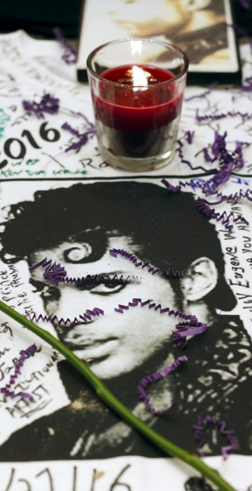Image: Flowers and candles are placed at a makeshift memorial for the music legend in Harlem, New York