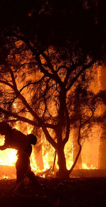 Image: Handout photo of a firefighter battling the Sherpa Fire in Santa Barbara, California