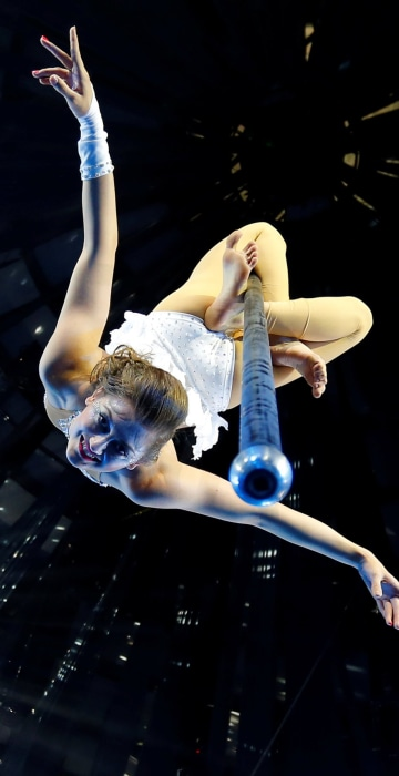 Image: Hungarian pole dancing champion Komenda performs during the rehearsal of her unique show on a suspended pole in Budapest's Grand Circus