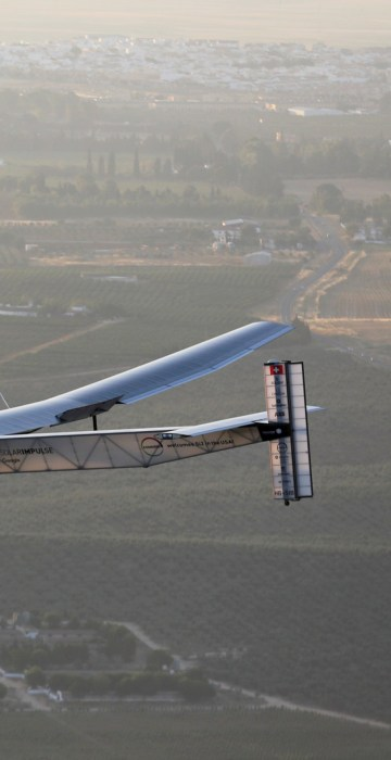 Image: The solar-powered plane Solar Impulse 2 is pictured before landing at San Pablo airport in Seville, southern Spain