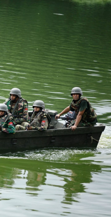 Image: Army soldiers patrol in a boat on a lake near the Holey Artisan restaurant after Islamist militants attacked the upscale cafe in Dhaka