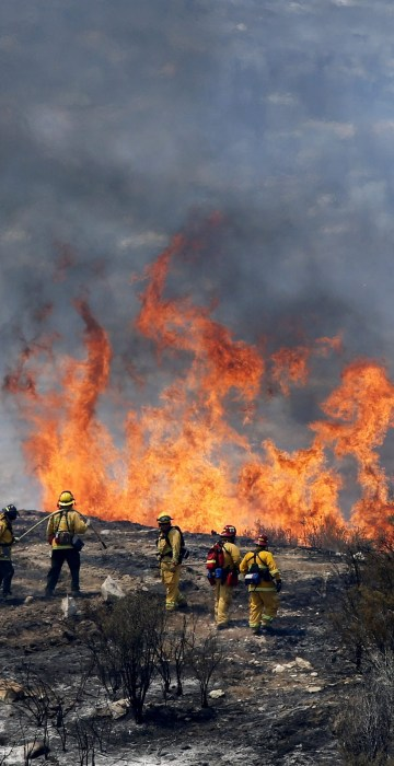 Image: Firefighters let a small area of the Sand Fire burn out near Acton