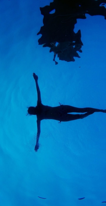 Image: A woman floats in a swimming pool during a summer day in Madrid