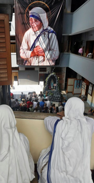 Image: Nuns from the Missionaries of Charity in Kolkata, India, watch a live broadcast of the canonisation of Mother Teresa