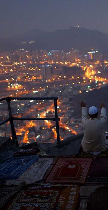 Image: A pilgrim prays at Mount Al-Noor ahead of the annual haj pilgrimage in the holy city of Mecca