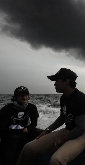 Image: Members of the marine wildlife conservation organization Sea Shepherd monitor the fuel tanker Burgos as it burns