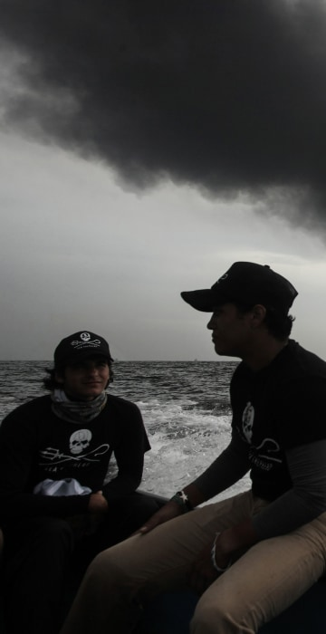 Image: Members of the marine wildlife conservation organization Sea Shepherd monitor the fuel tanker Burgos as it burns