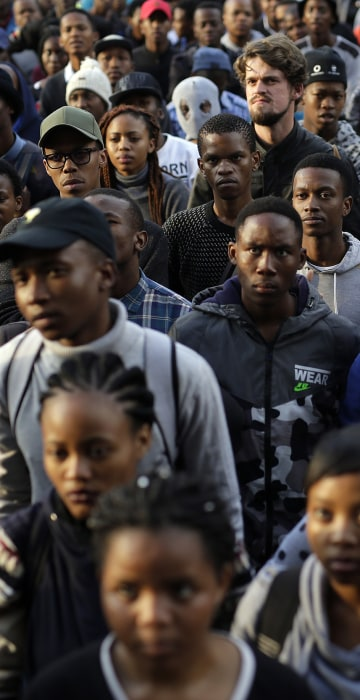 Image: Students listen to Economic Freedom Front (EFF) activist and student leader Vuyani Pambo